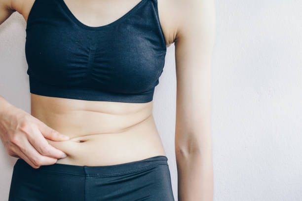 mujer, quema de grasa, estómago